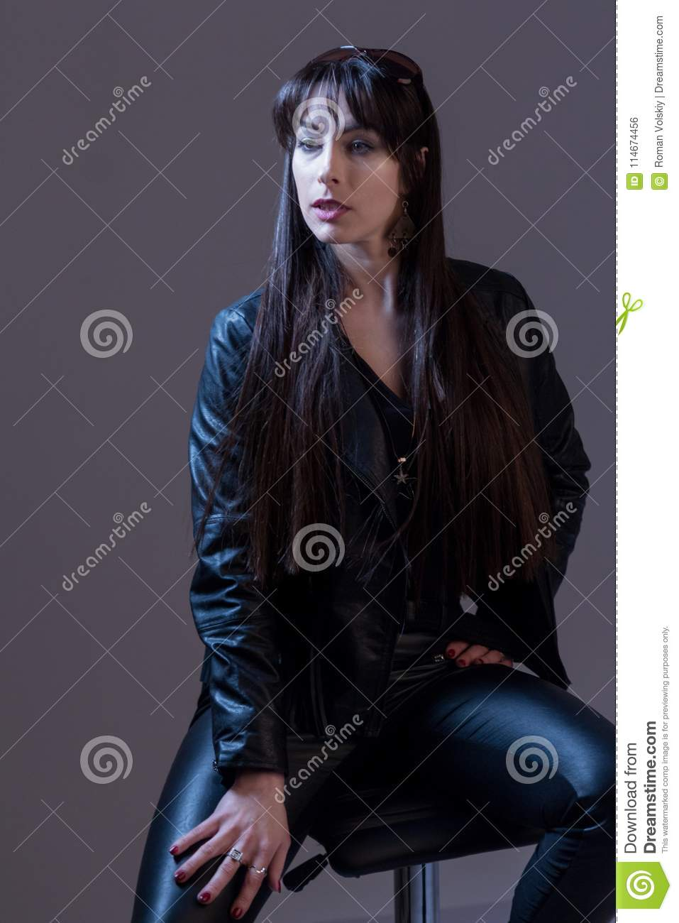 8d40f13bf65 Portrait Of A Beautiful Girl With Long Hair In Black Leather Clothes ...