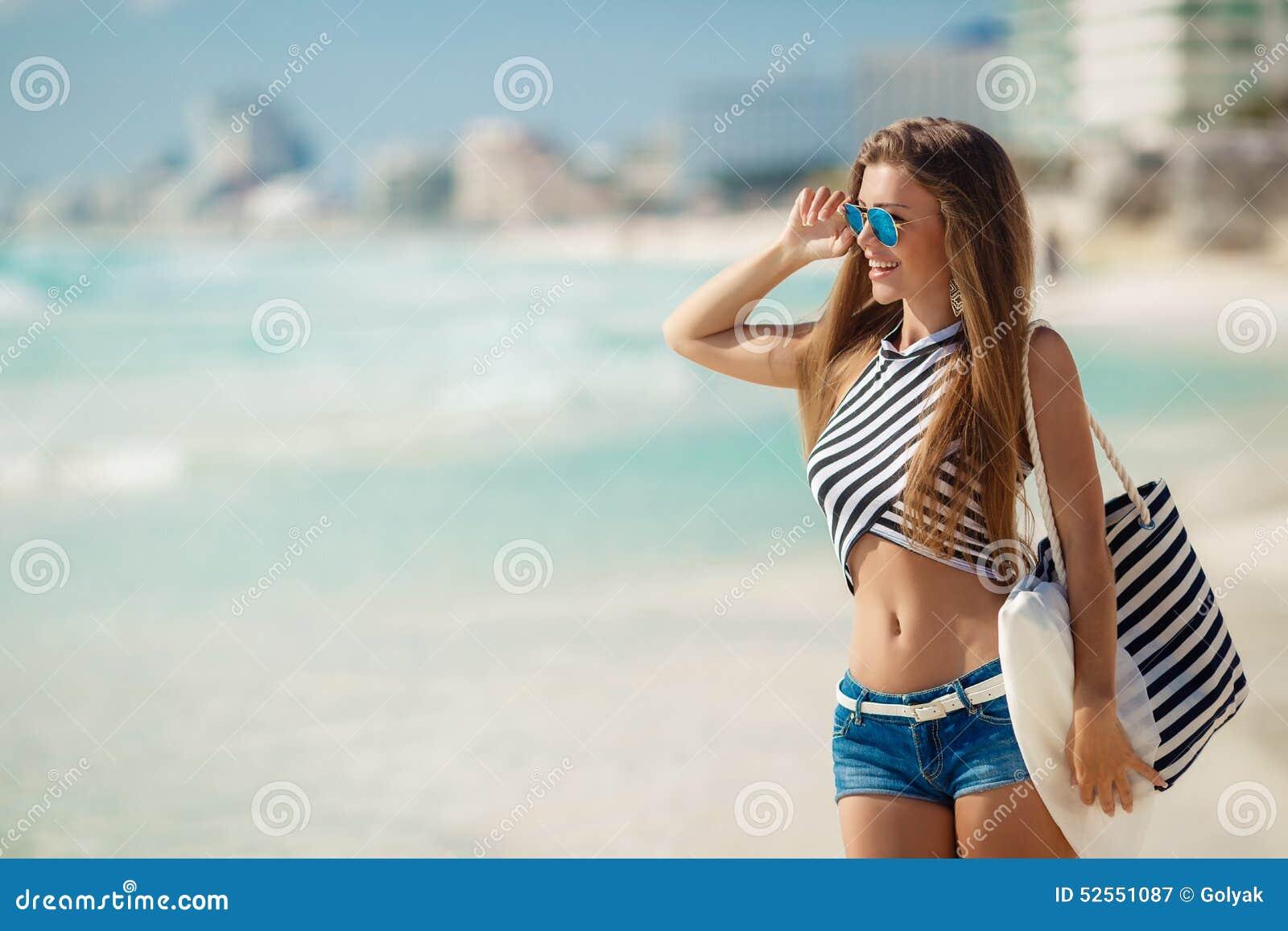 Portrait Of Girl With Beach Bag On The Beach Stock Photo