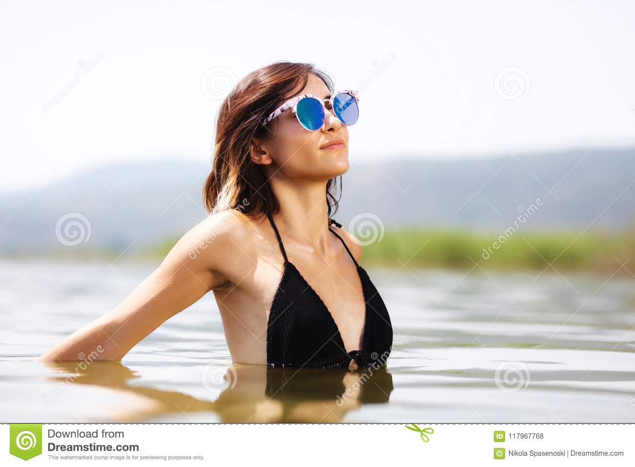 girl with glasses in water