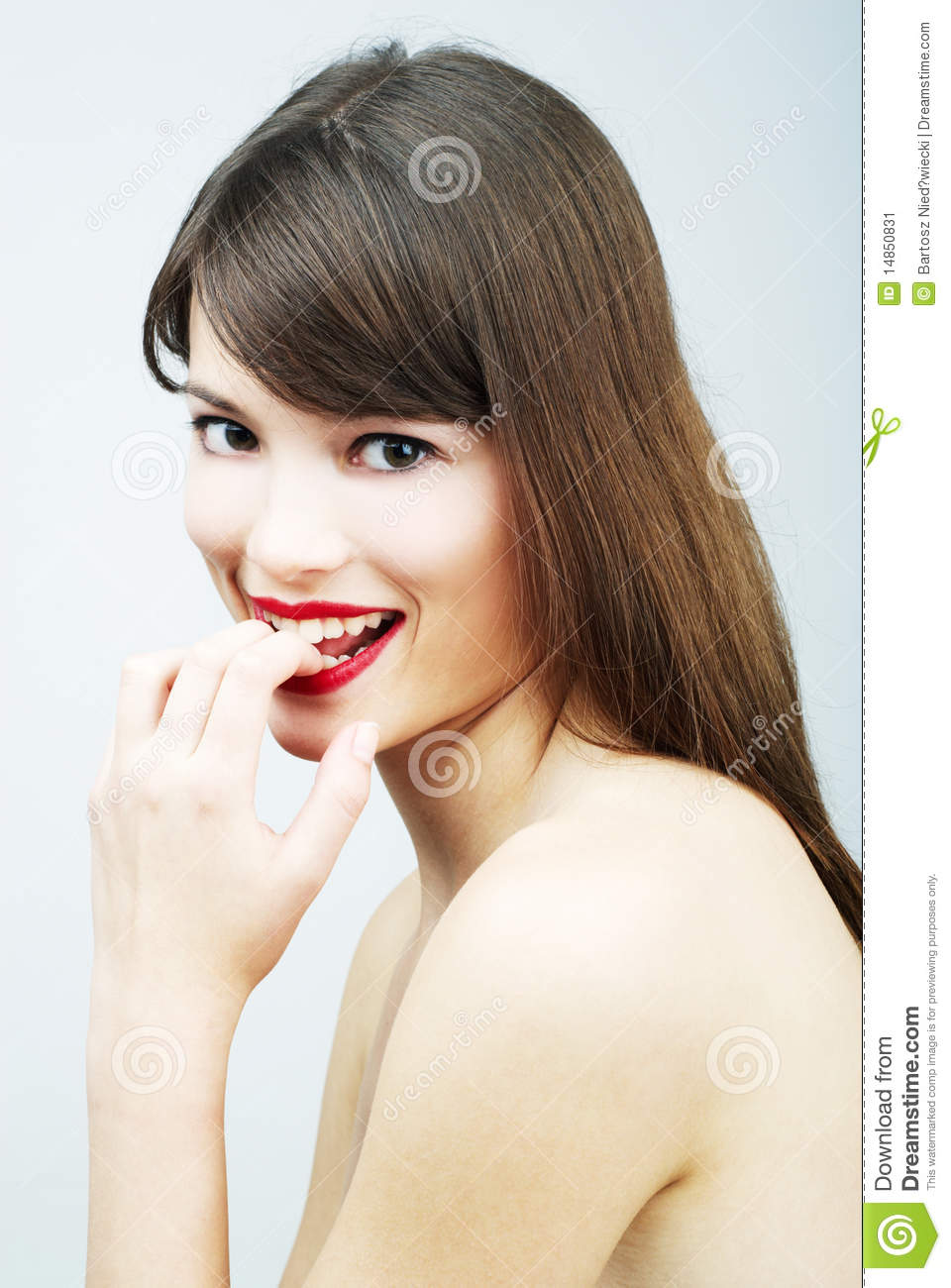 Portrait of a woman biting her finger
