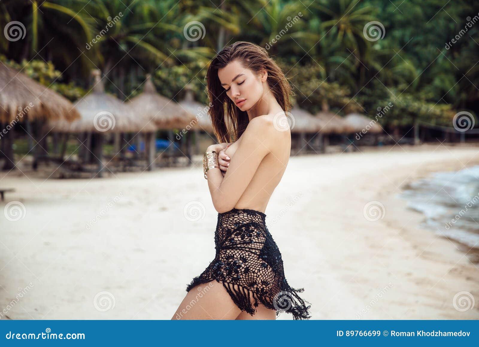 4a8cce679c Portrait Of Woman In Black Bikini Swimwear