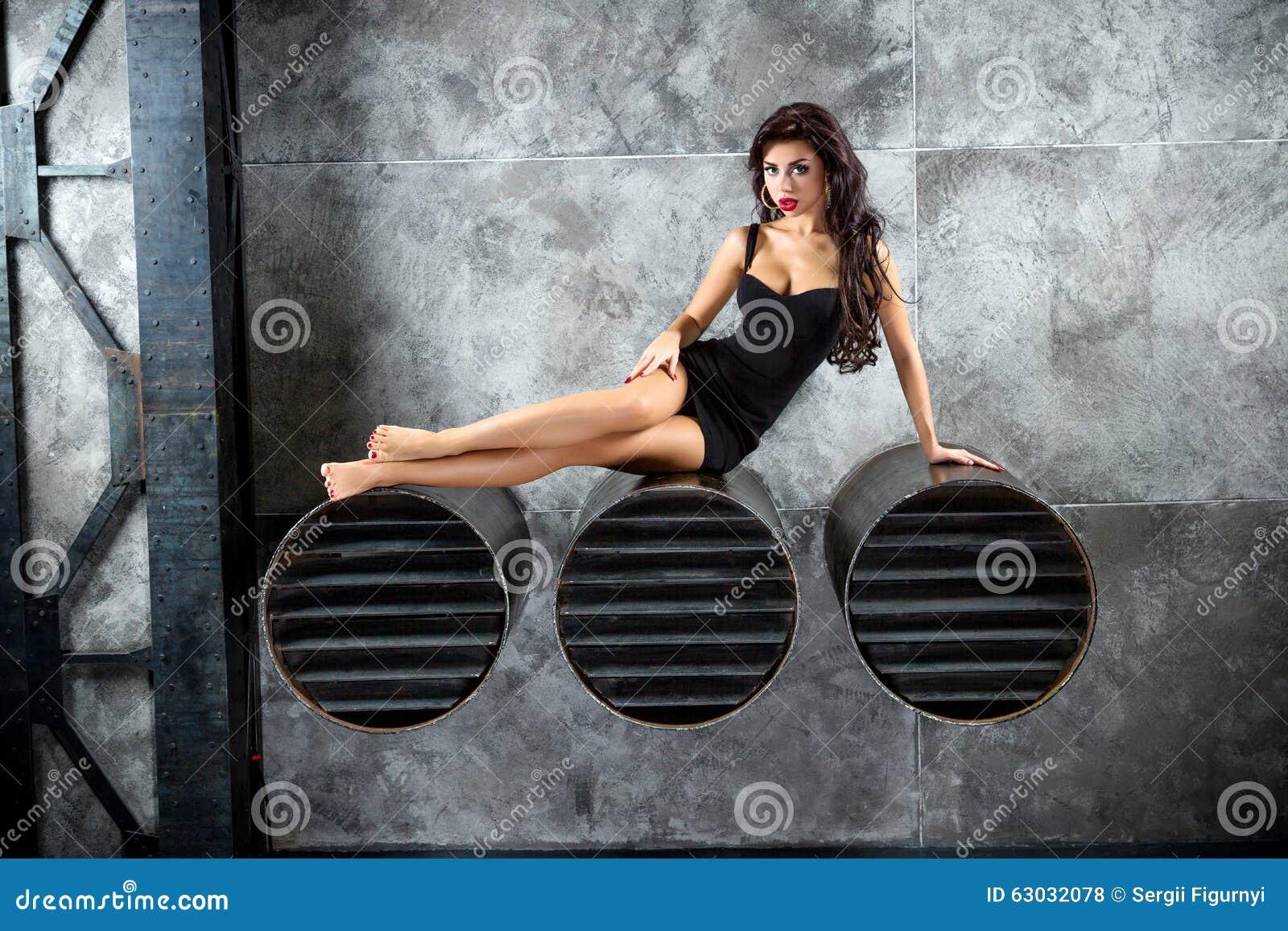 Portrait Of Woman On a dark metallic Background