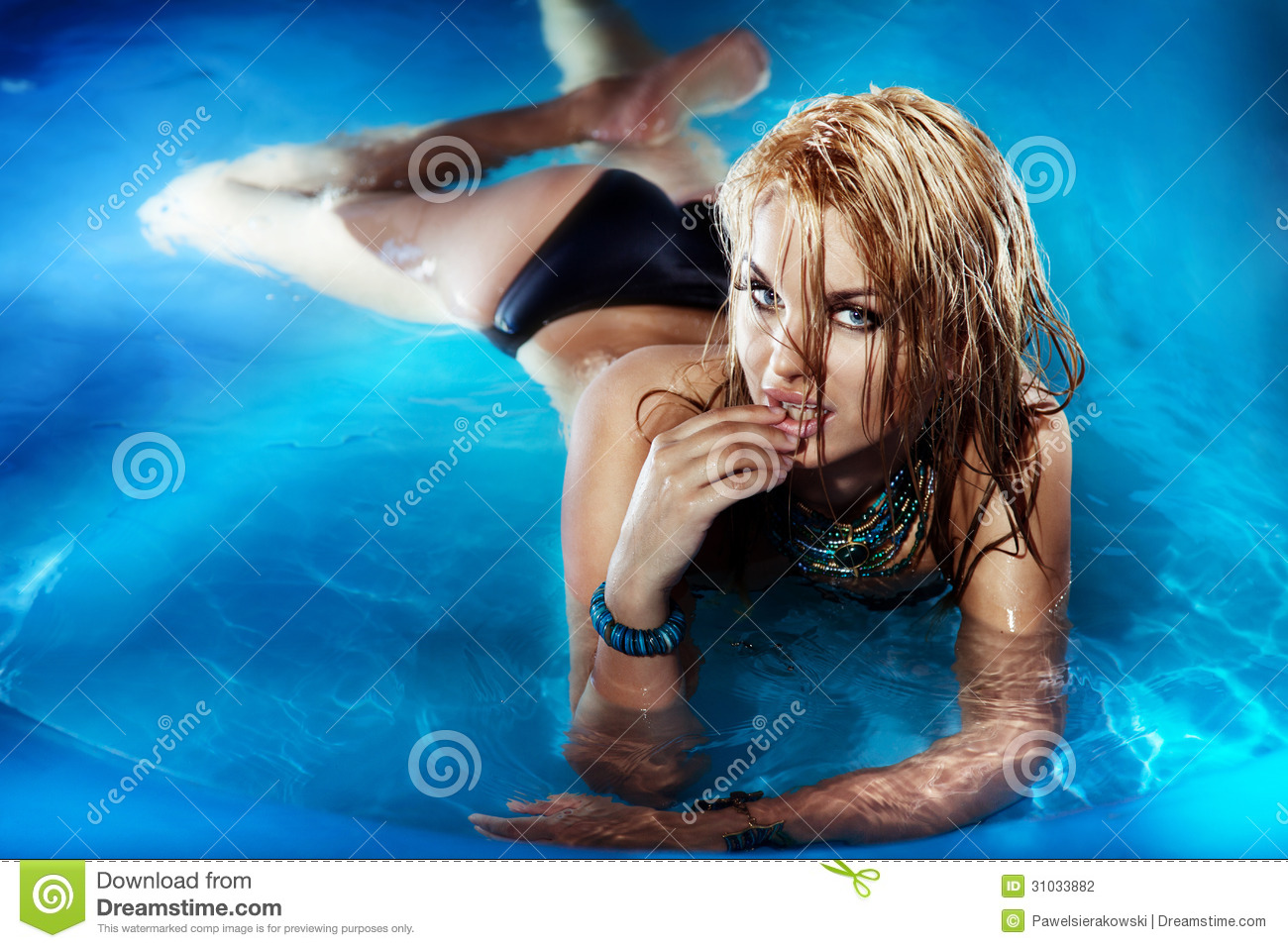 Portrait of young female enjoying in swimming pool.