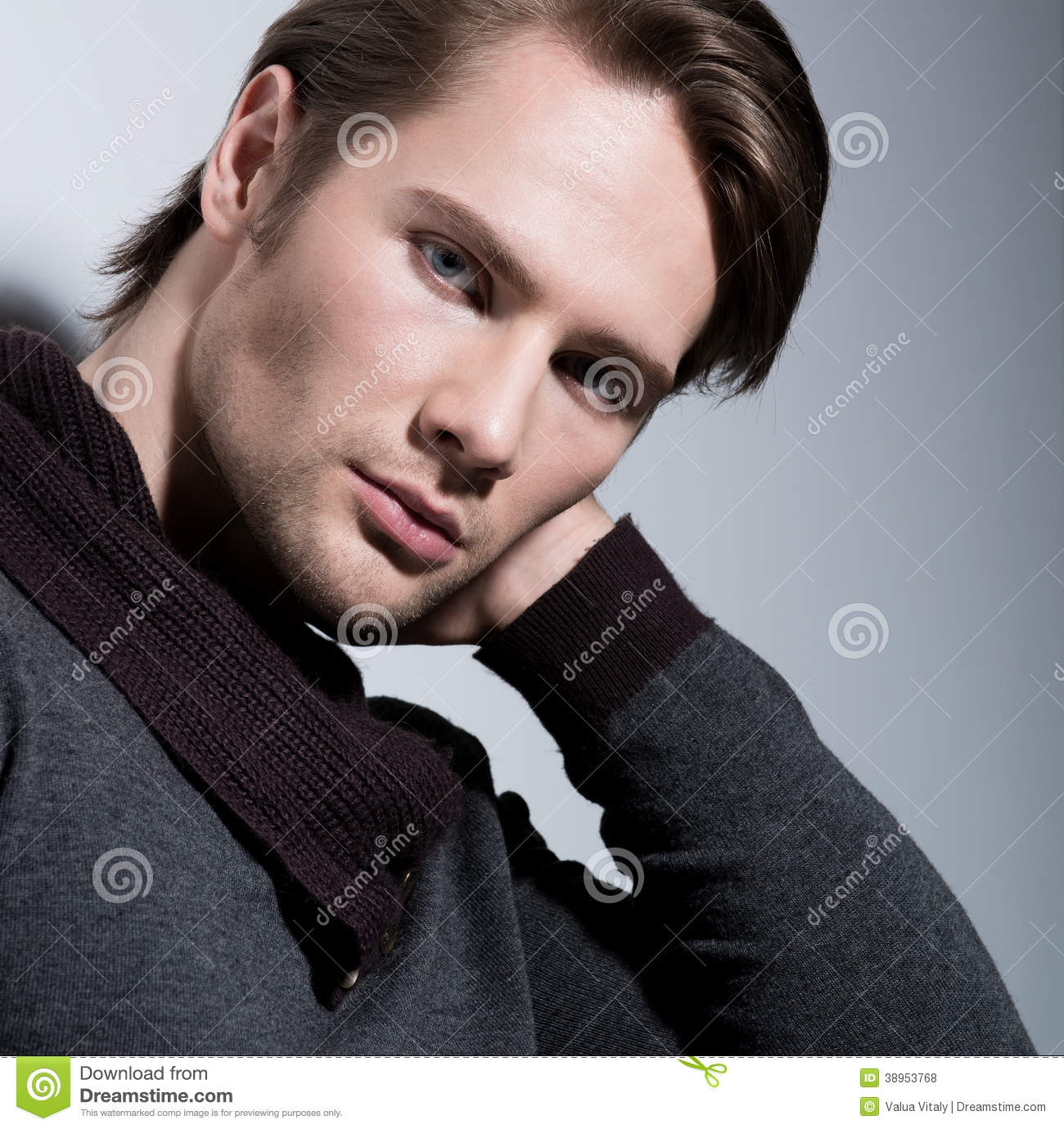 Portrait Of Young Man With Hand Near Face Stock Photo