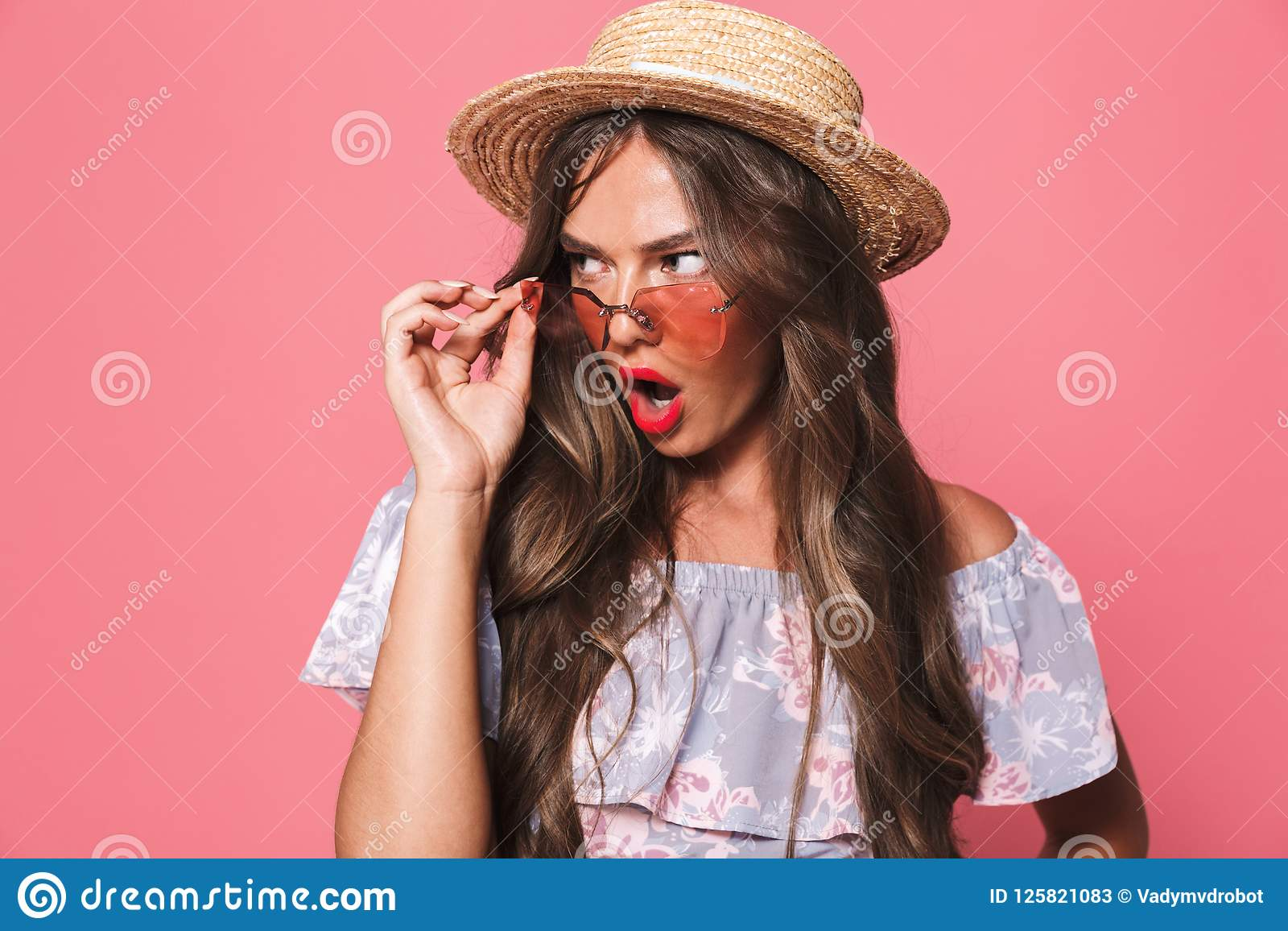 Portrait of a shocked young girl in summer clothes