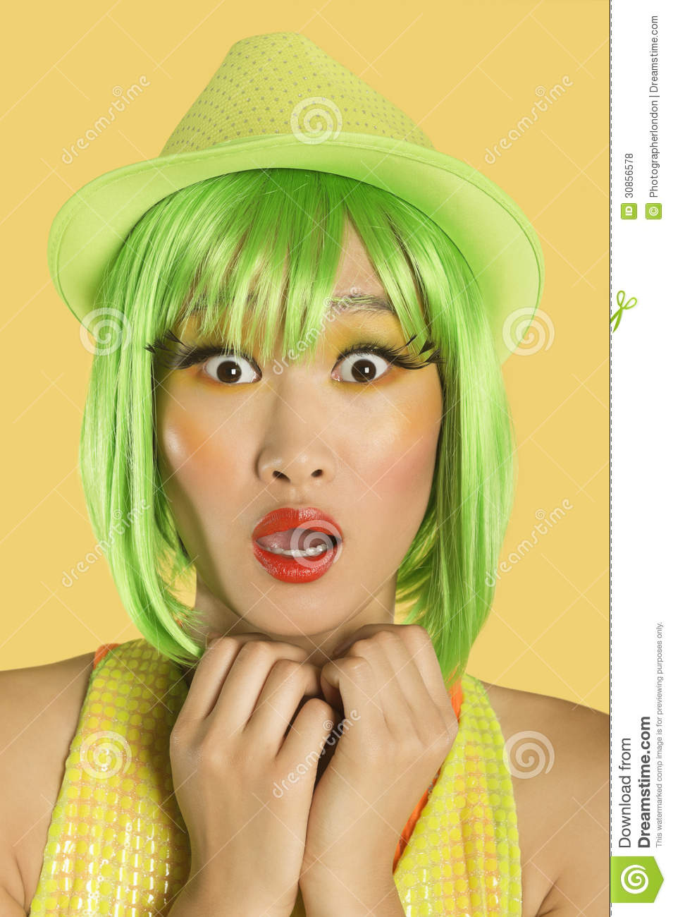 Portrait Of Shocked Young Woman With Green Hair Against