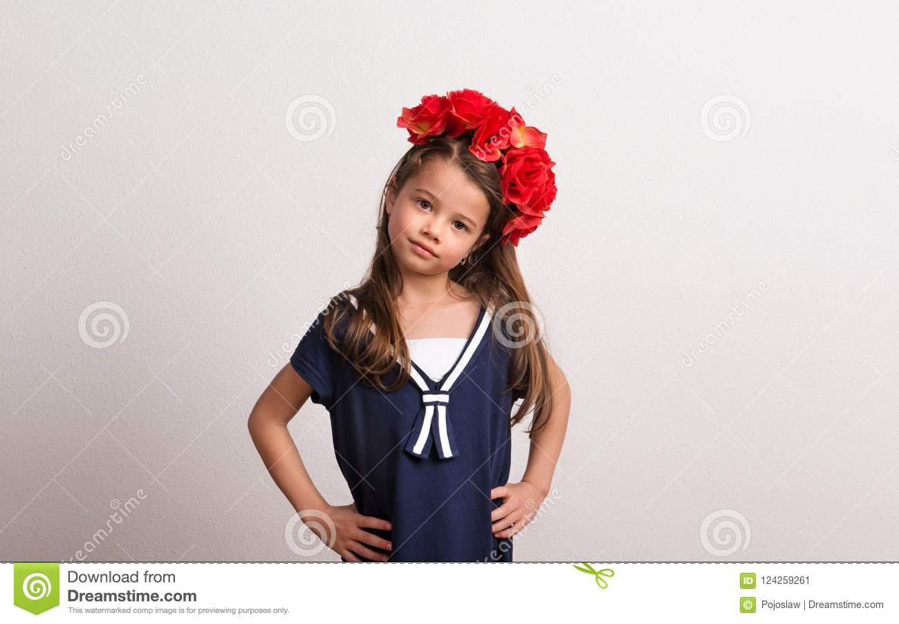 Portrait Of A Small Girl With Flower Headband In Studio On A White
