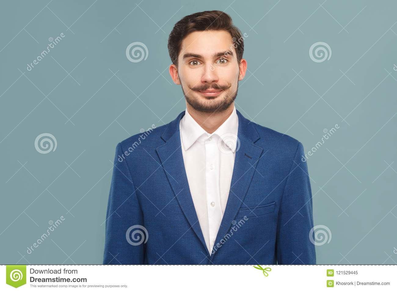 3bf22c84643 Portrait of smiley handsome bearded businessman with mustache in blue suit  and white shirt