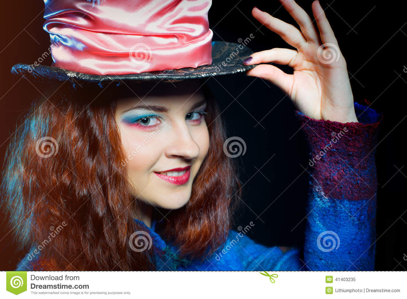Portrait of smilimg young woman in the similitude of the Hatter