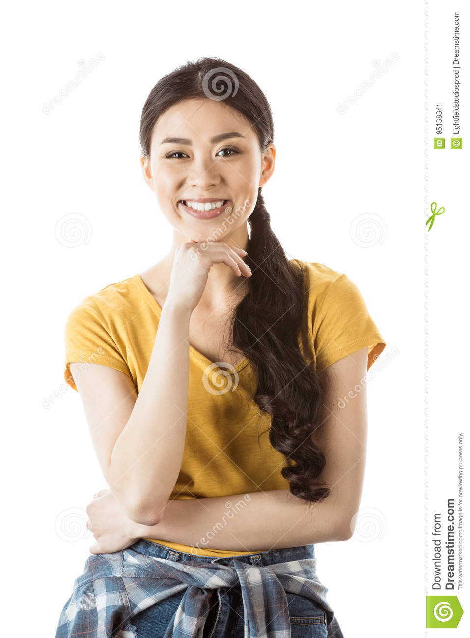 Portrait of smiling asian woman with hand on chin