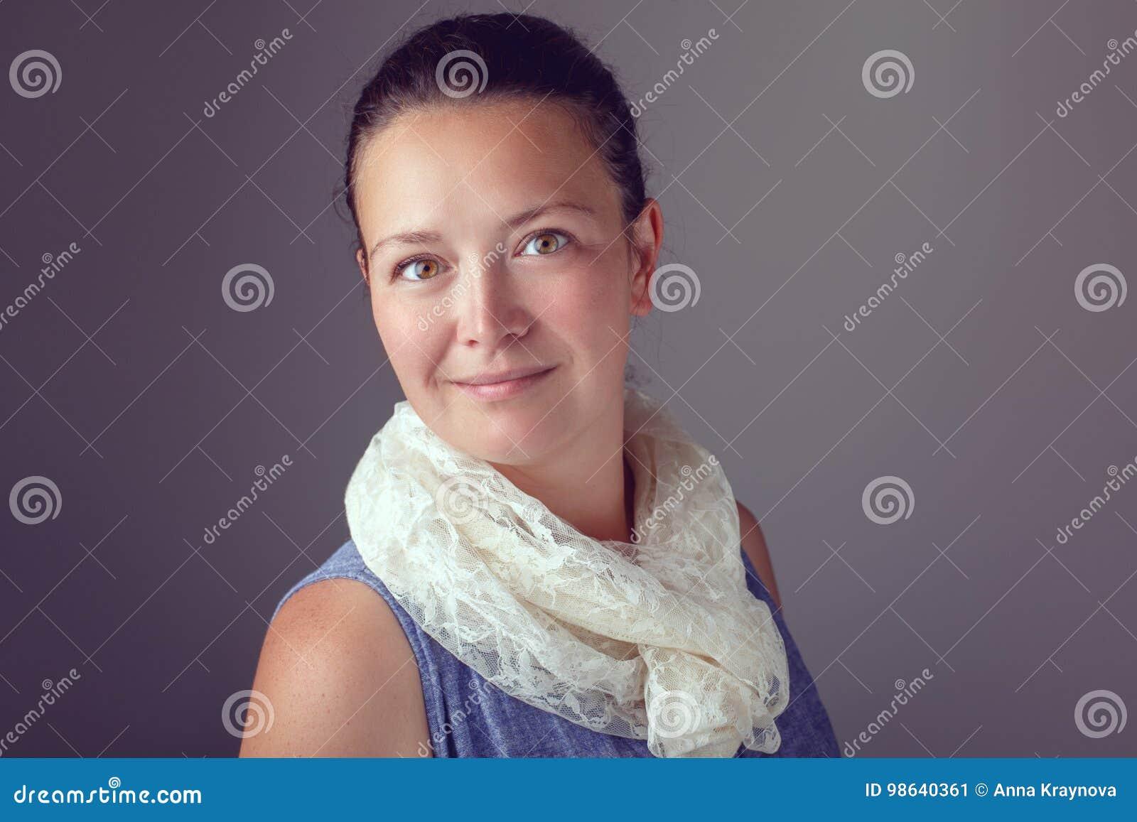 Smiling beautiful Caucasian brunette woman with dark hair and brown hazel eyes