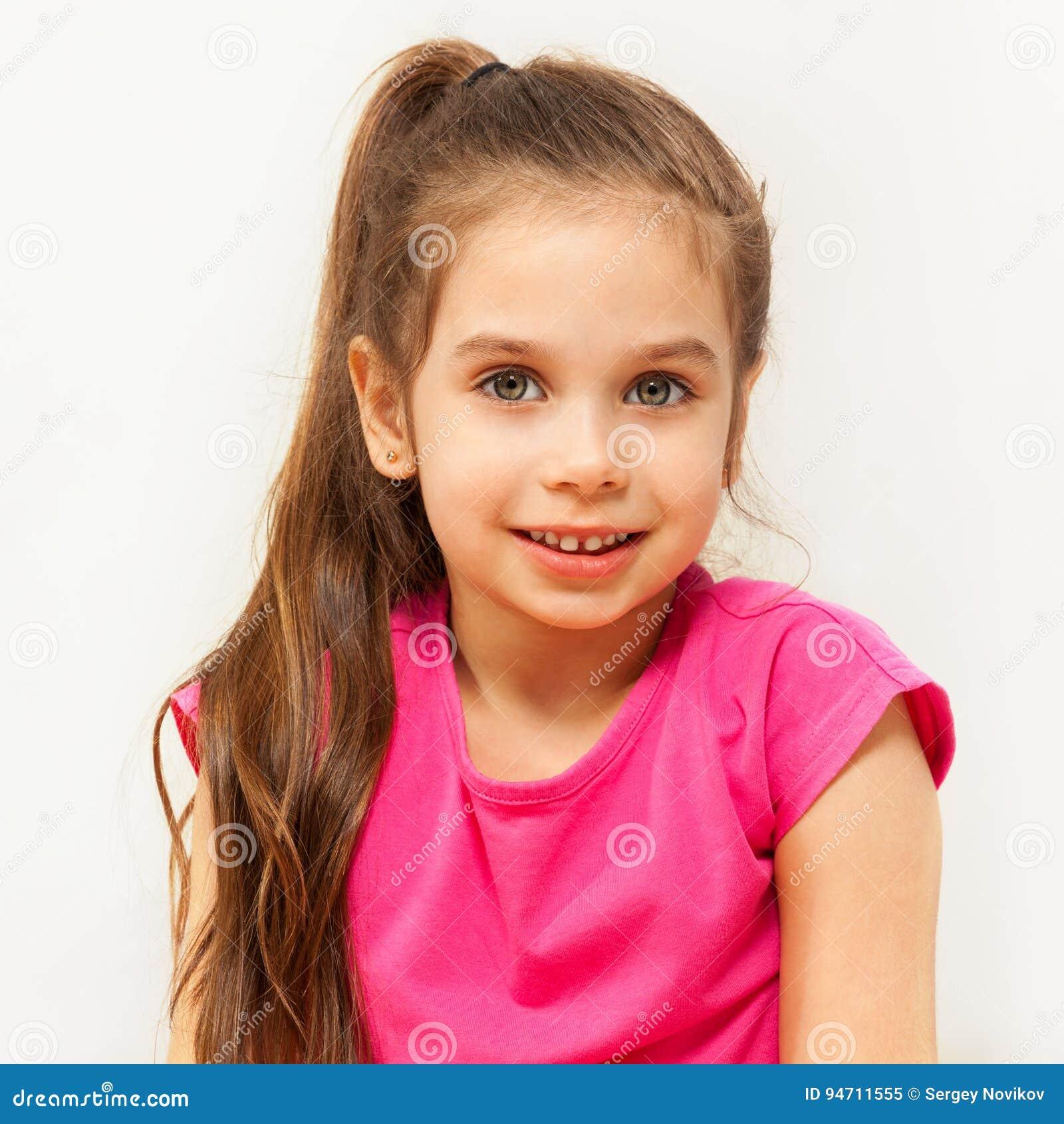 Portrait of smiling brunette seven years old girl