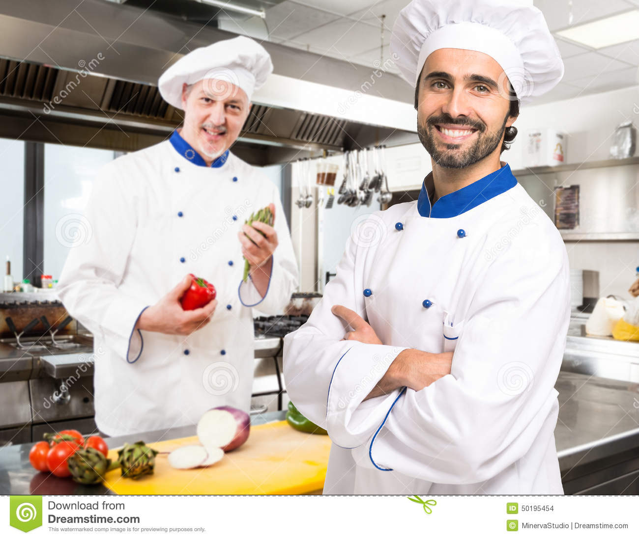 Portrait Of Smiling Chefs In A Kitchen Stock Photo - Image of cook ...