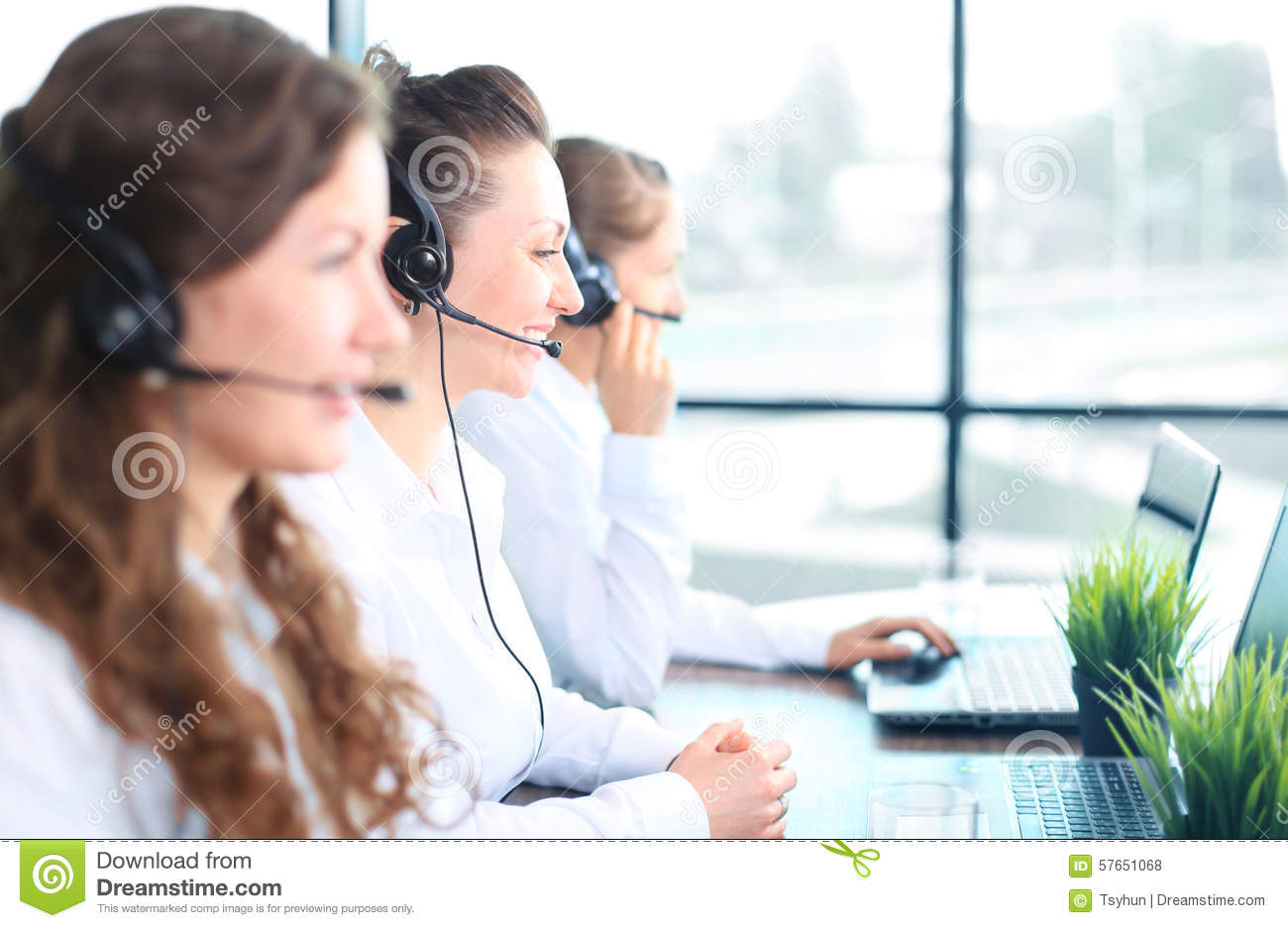 Portrait of smiling female customer service agent