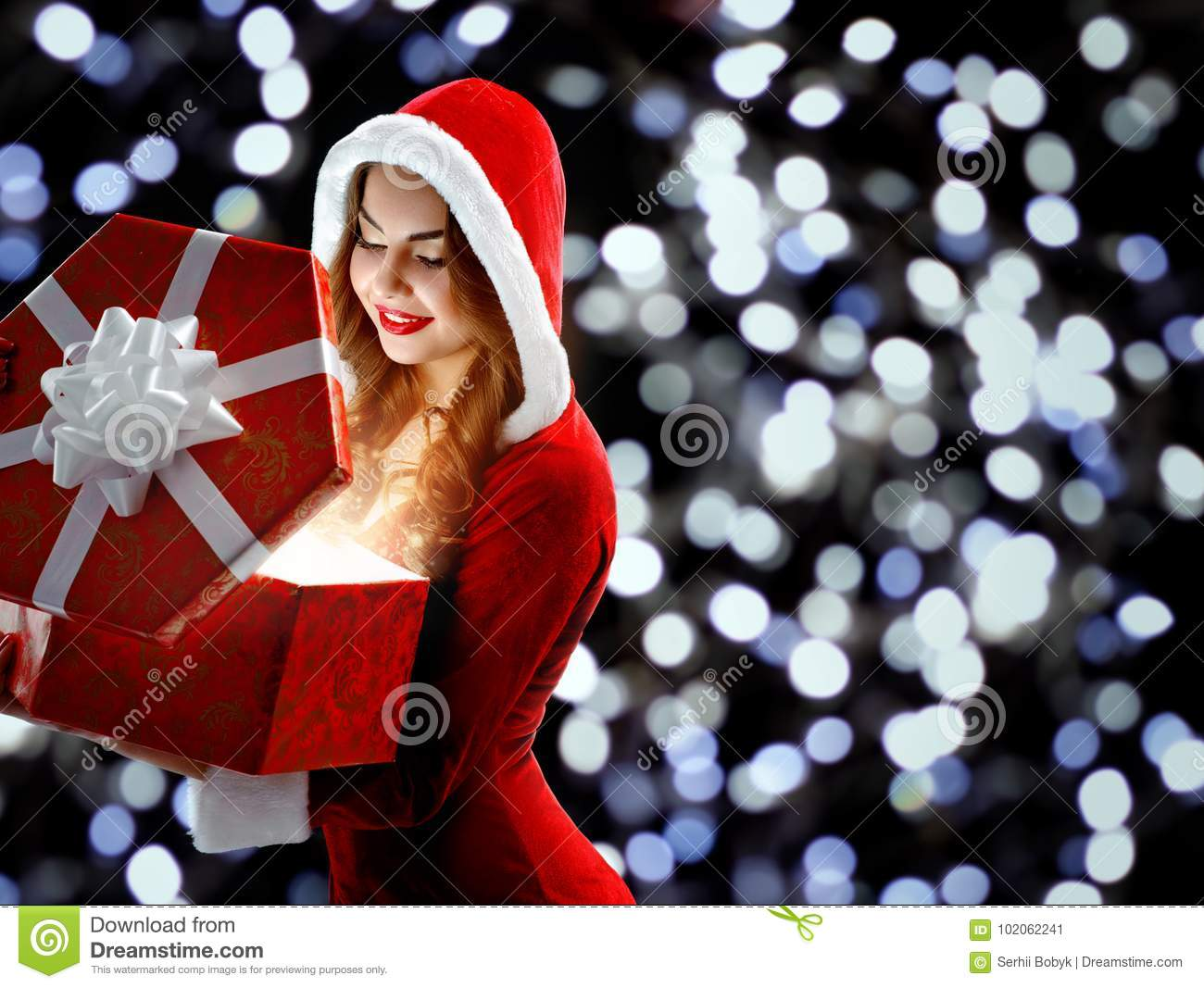Girl In The Red Suit Holding A Gift For New Year 2018,2019 Stock ...