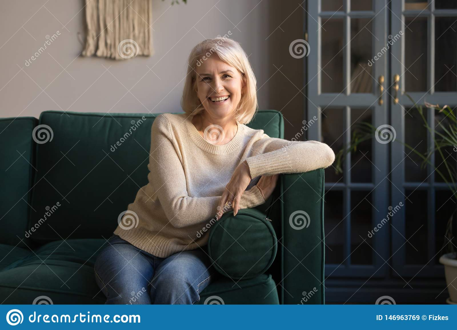 Portrait of smiling grey haired mature woman looking at camera