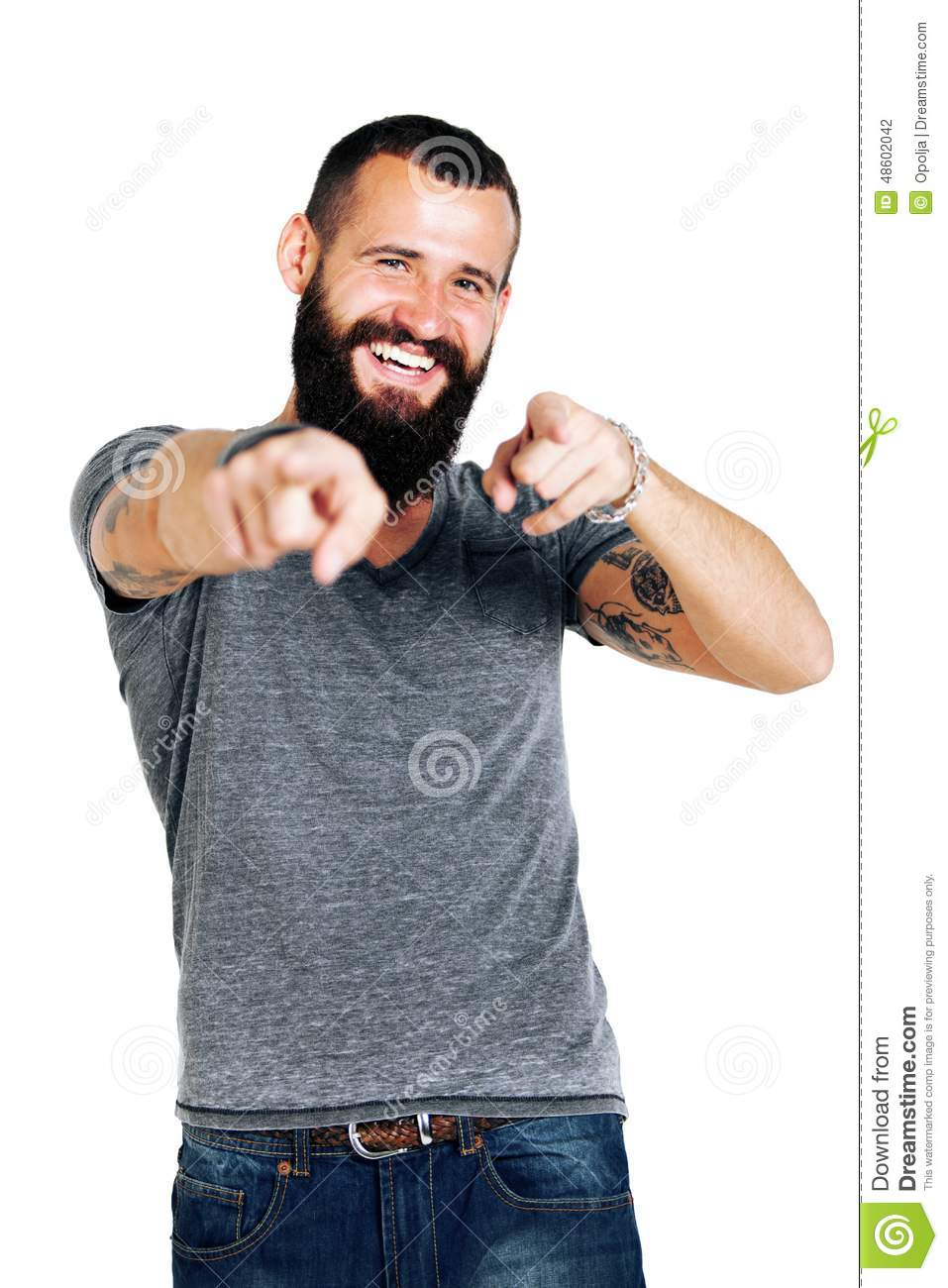 Portrait of smiling handsome Tattooed bearded man pointing