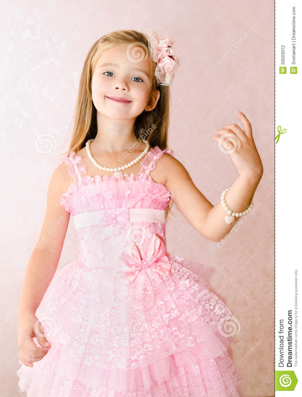 Portrait Of Smiling Little Girl In Princess Dress With A Bracele ...