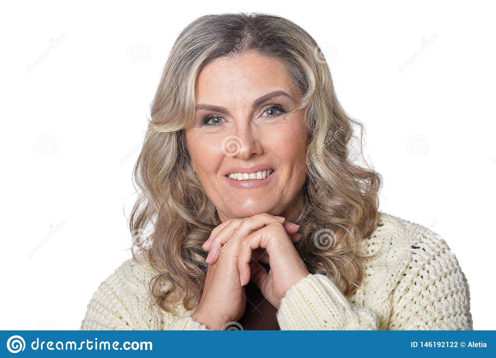 Portrait of smiling mature woman looking at camera isolated