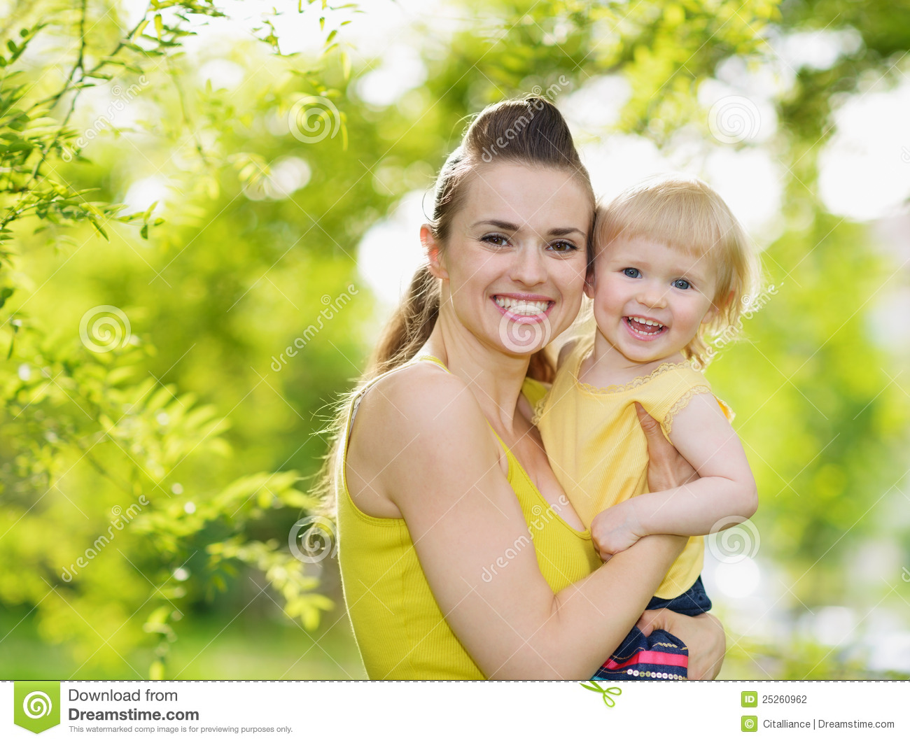 938086eb4 Portrait Of Smiling Mother And Baby Girl Outdoors Stock Photo ...