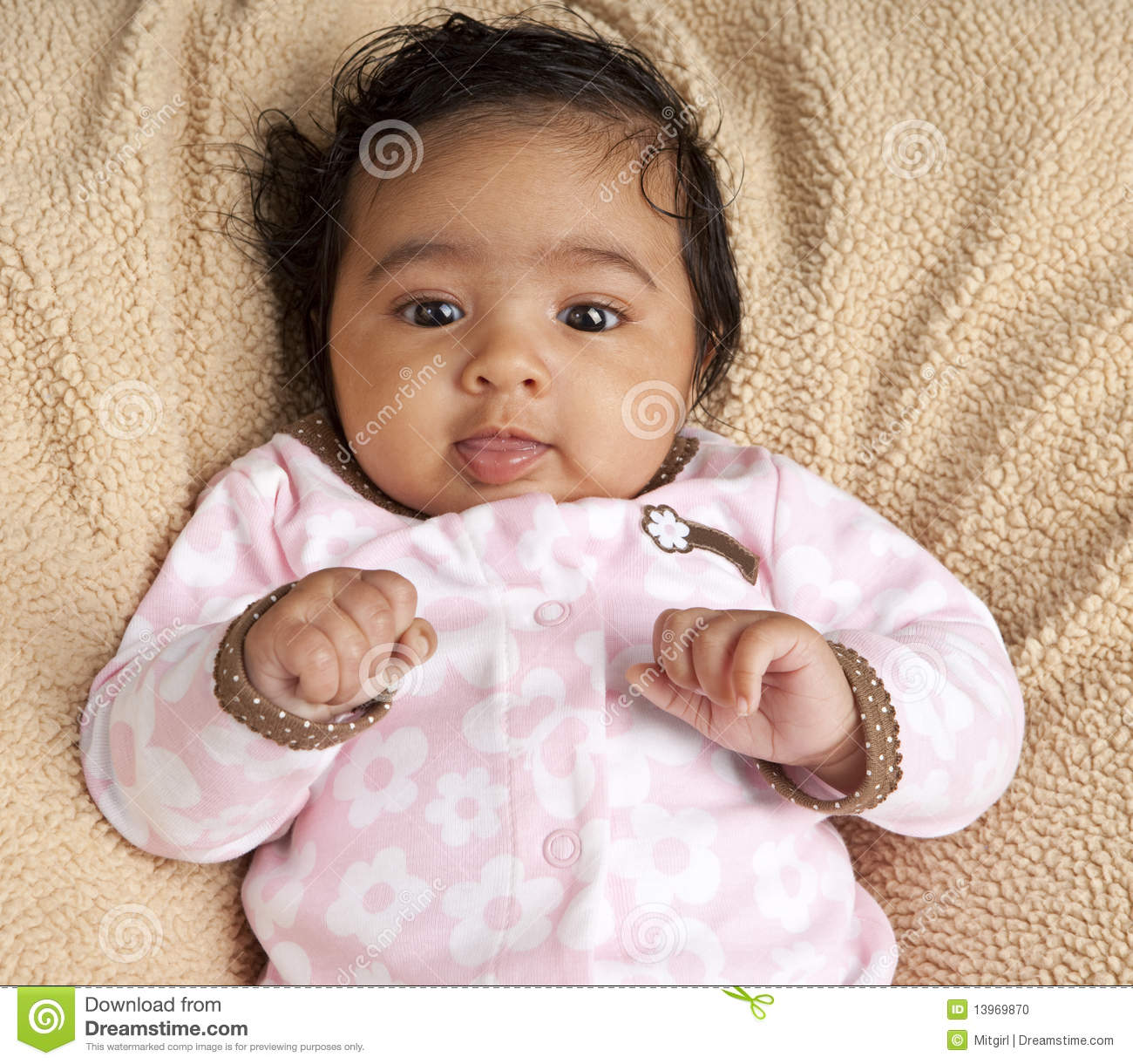 Portrait Of A Smiling Newborn Baby Girl Stock Photo
