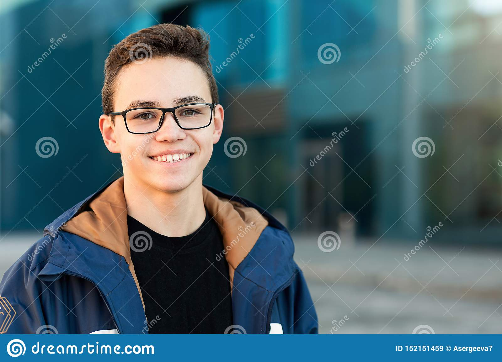 Portrait of smiling teenager outdoors, closeup. Copy space