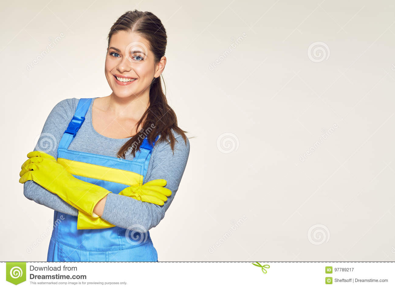 Portrait of smiling woman dressed cleaner uniform with crossed a