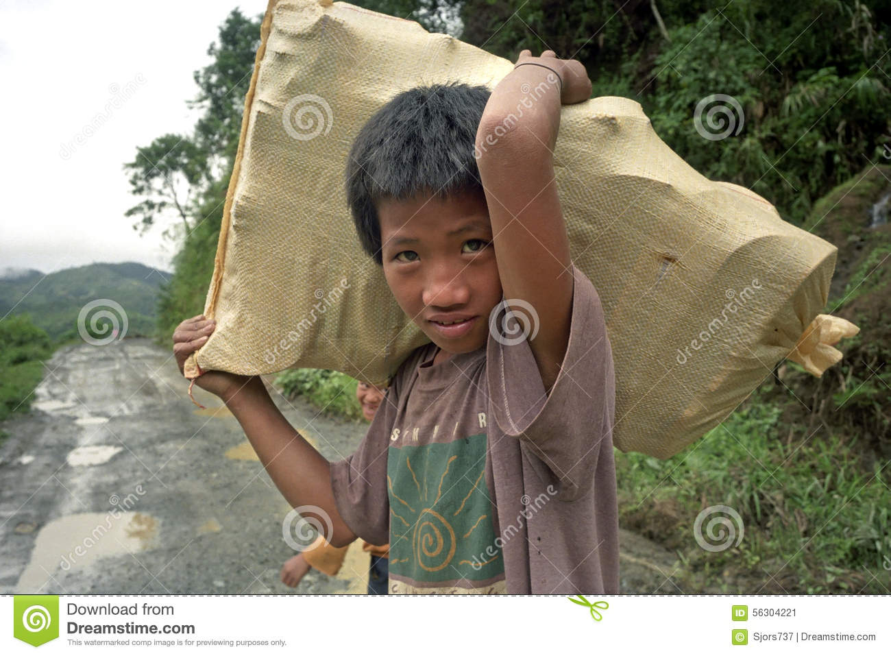 Portrait of smiling, working, Filipino boy