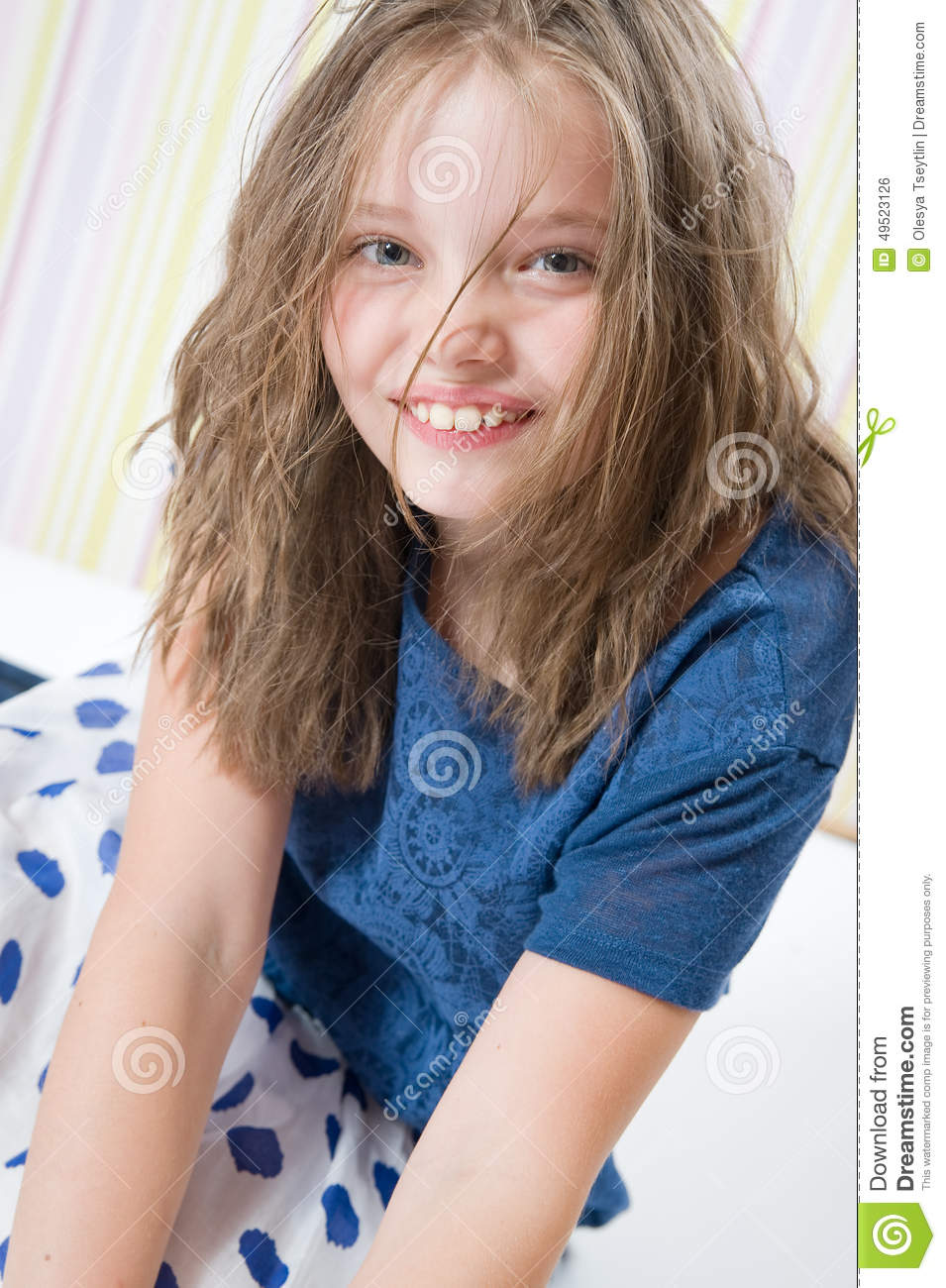8 Year Boy Bedroom Design: Portrait Of A Smiling 8 Year Old Girl In A Hat Stock Photo