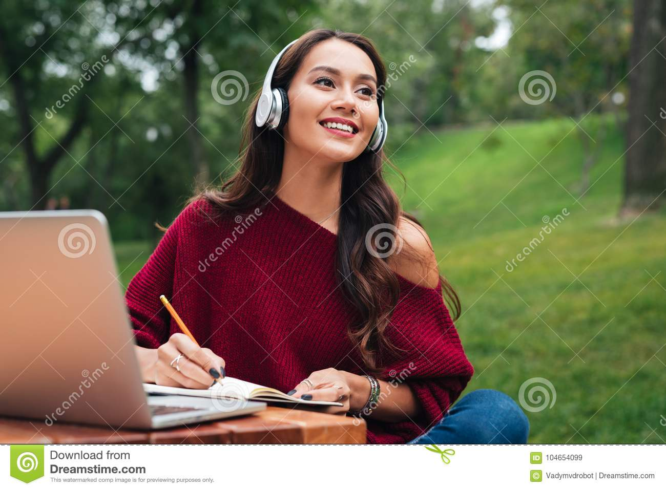 Portrait of a smiling young asian girl in headphones