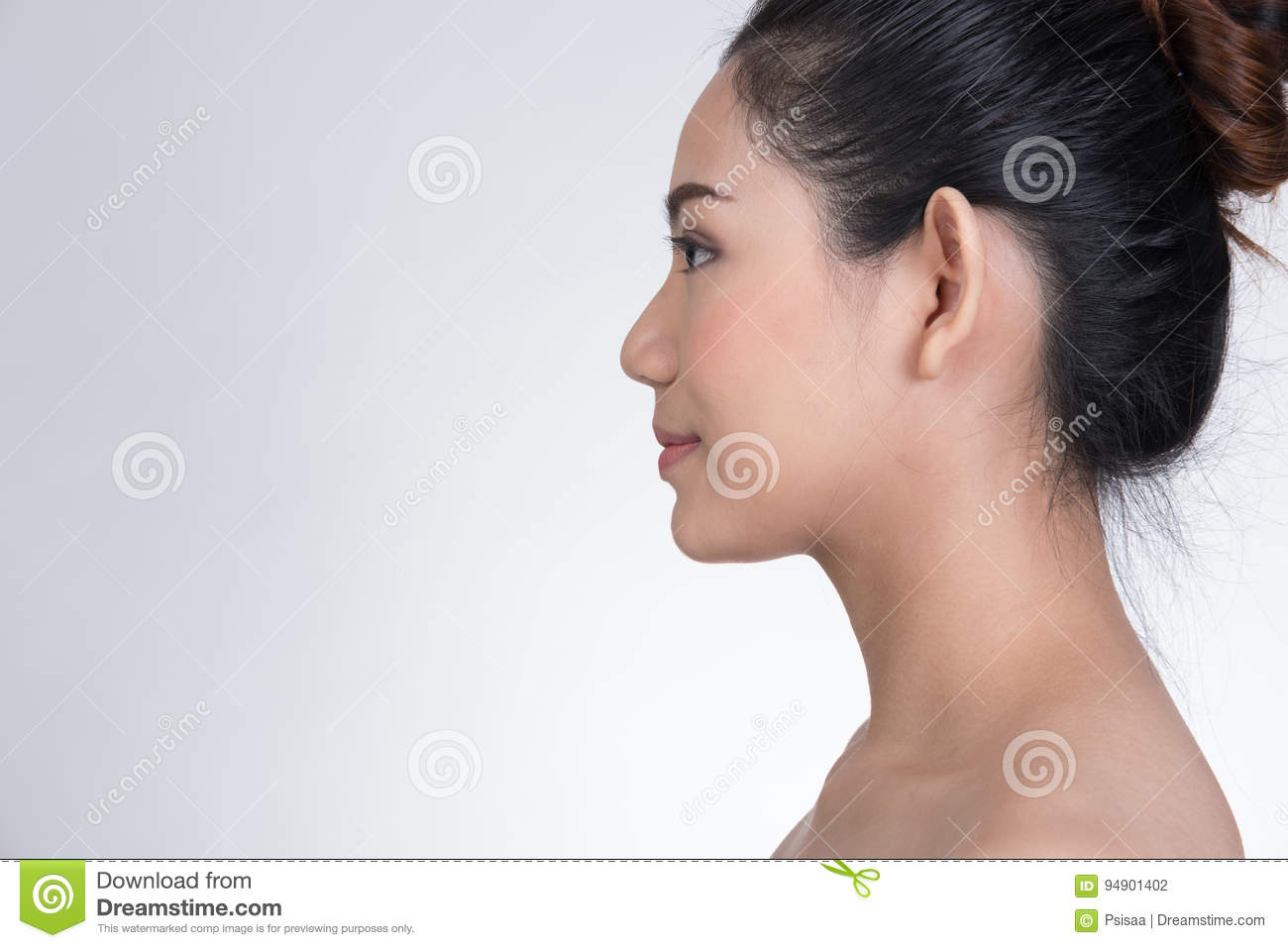 Portrait Of A Smiling Young Woman With Natural Make-up