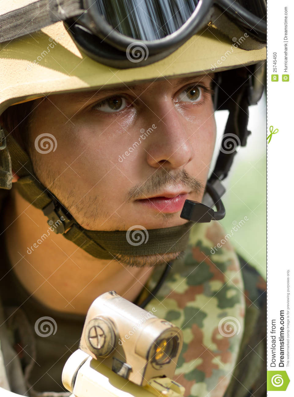 Portrait of a soldier in helmet with headset