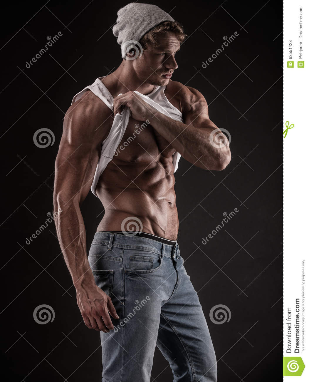 Portrait of strong Athletic Fitness man over black background