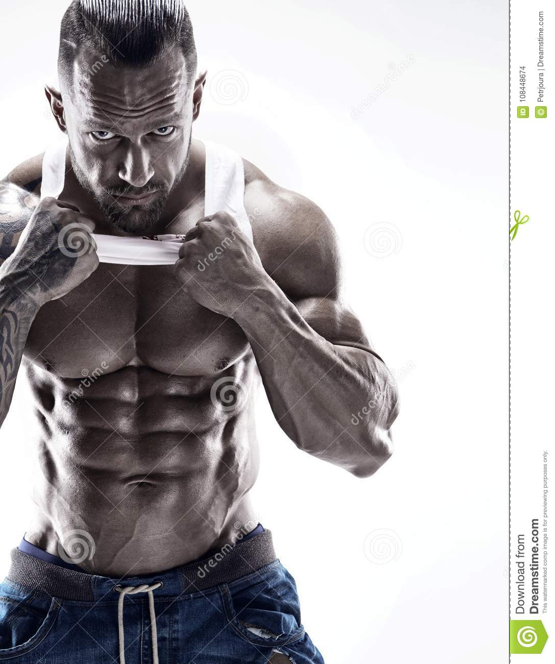 Portrait of strong Athletic Fitness man showing big muscles