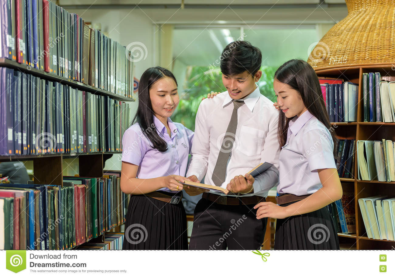 Portrait of students studying in library