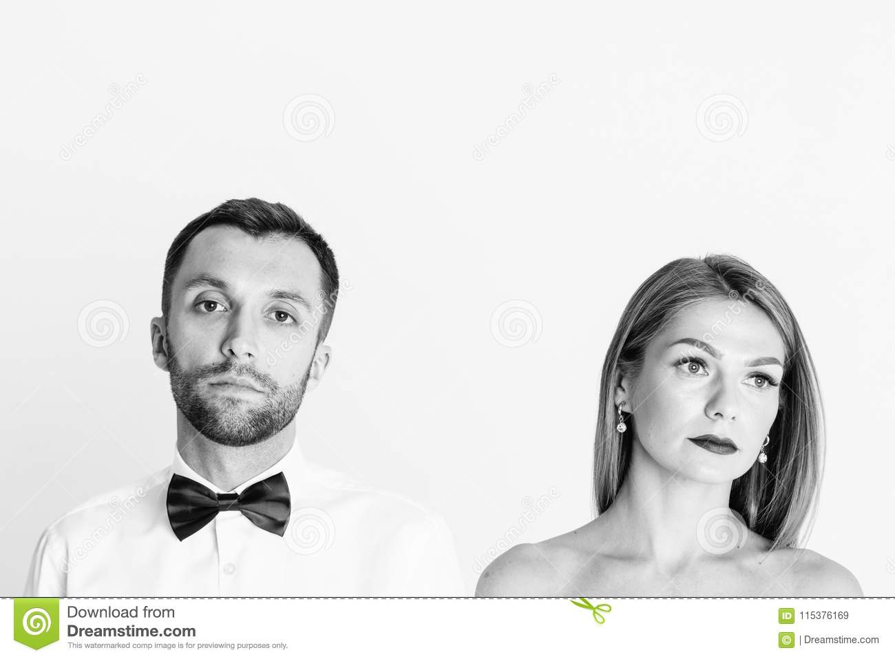Portrait of stylish young couple, pretty woman with naked should