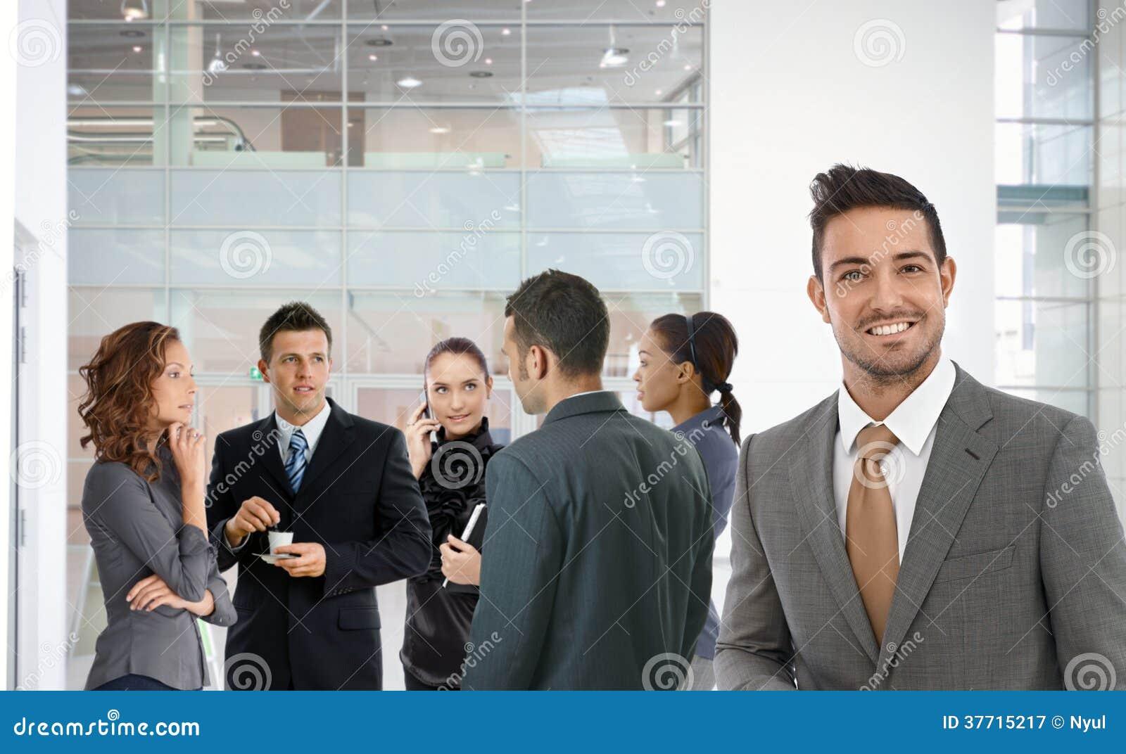 Portrait of successful businessman smiling happy