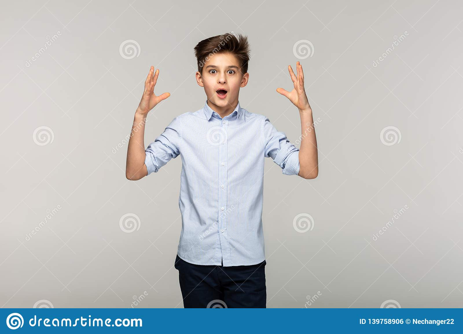Portrait of surprised young boy in blue shirt royalty free stock image