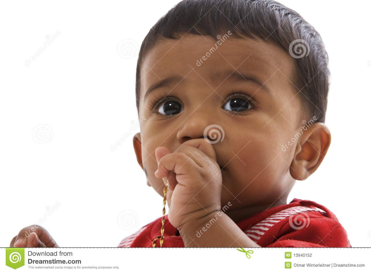 Portrait Of Sweet Indian Baby Looking Straight Stock