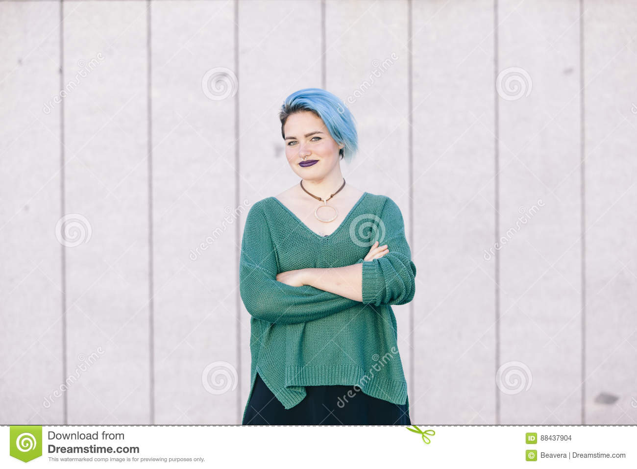 Portrait of a teen androgynous woman with blue dyed hair isolate