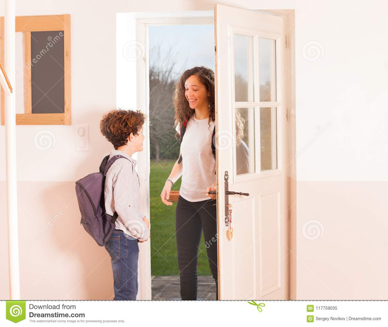 happy children come back home from school stock image