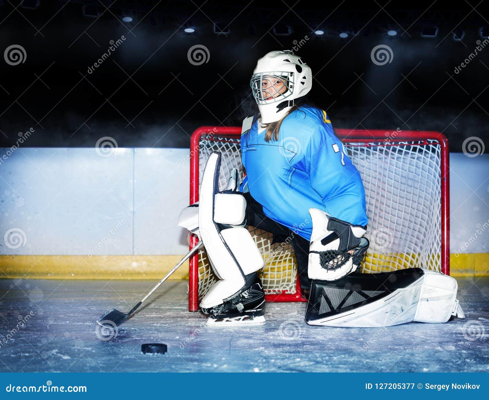 Girl Goaltender Protecting Net During Hockey Match Stock Image