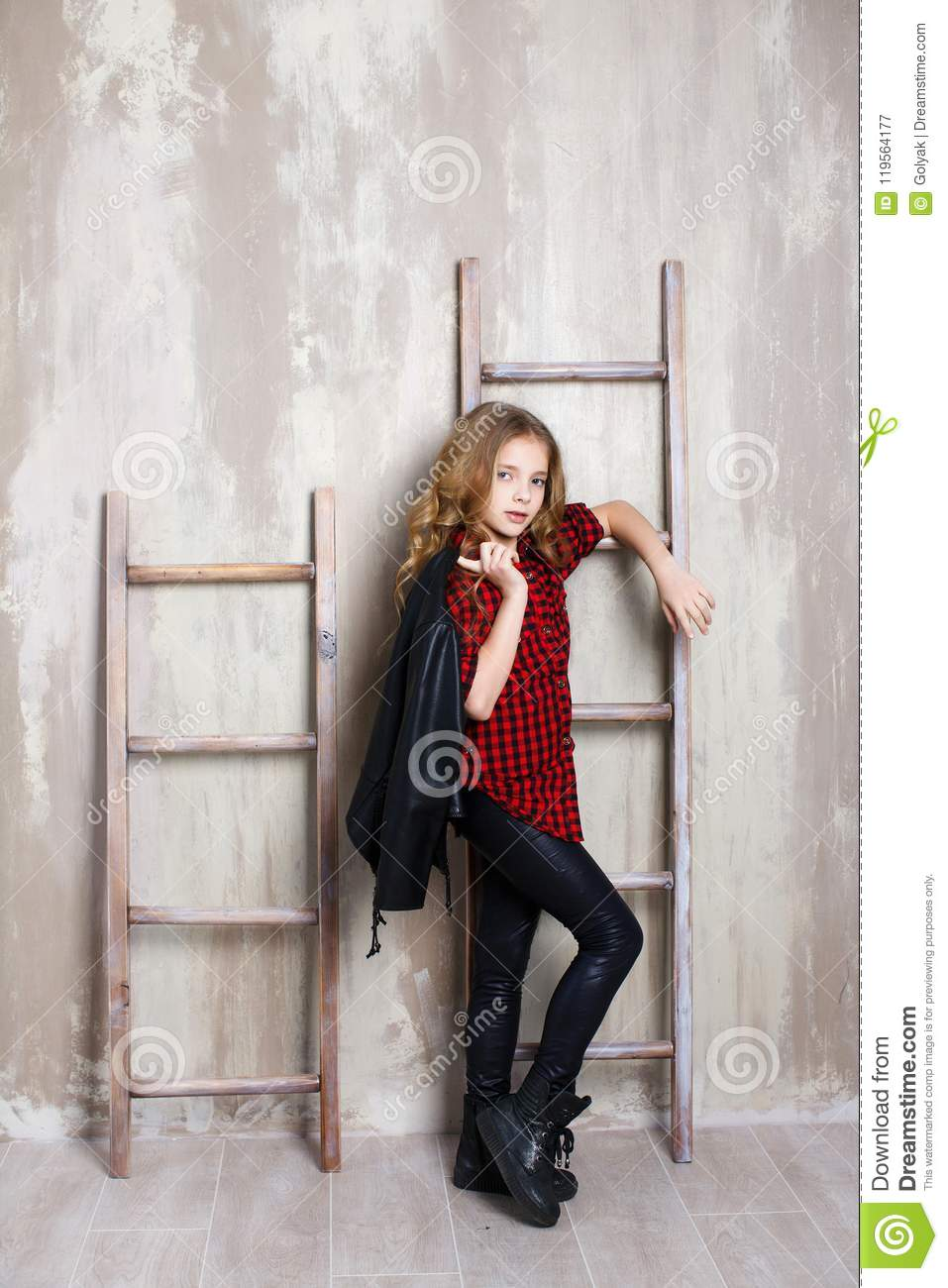 522abade2b9b Portrait Of A Cute Teenage Girl On A Gray Background Stock Image ...