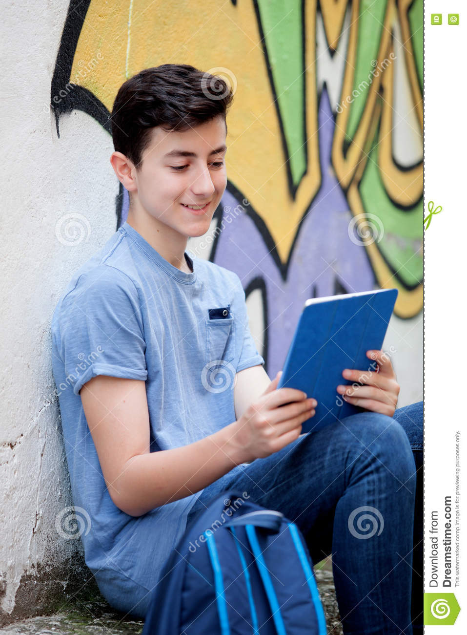 Portrait of a teenager guy with a tablet on the street stock image royalty free stock photo voltagebd Images