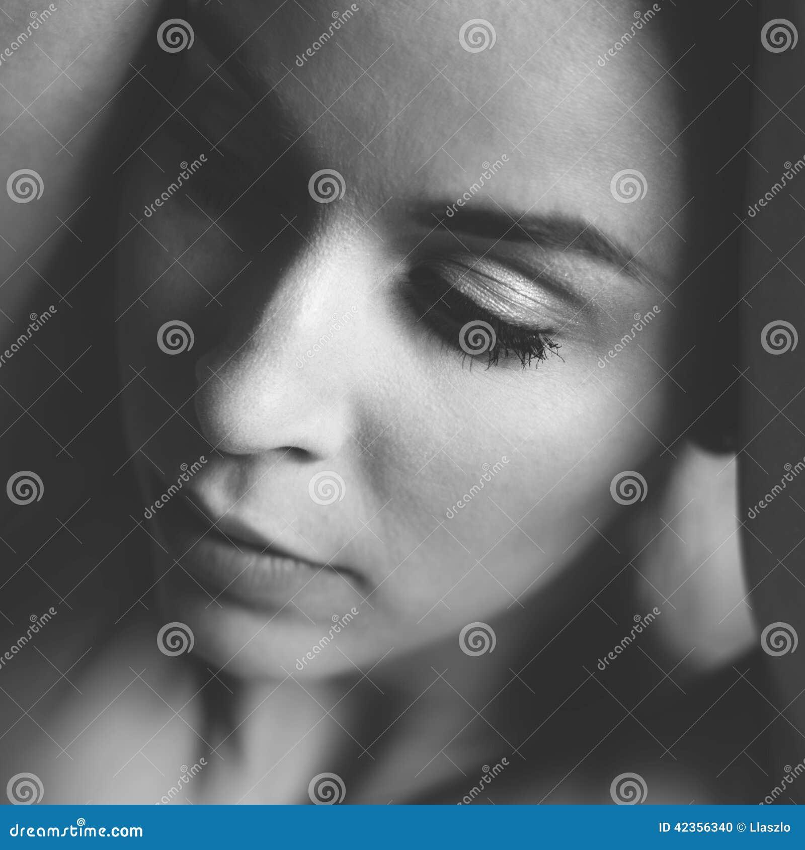 Portrait Of Thinking Woman Stock Photo