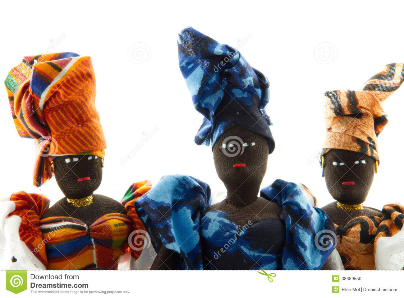 portrait of three african dolls wearing head wraps stock