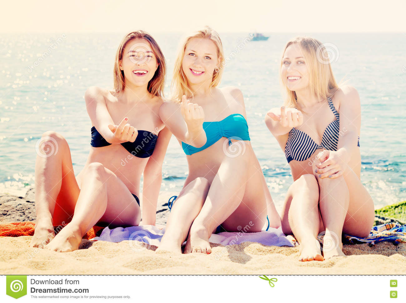 a9ed46ac264 Portrait Of Three Cheerful Young Women Resting Together On Beach ...