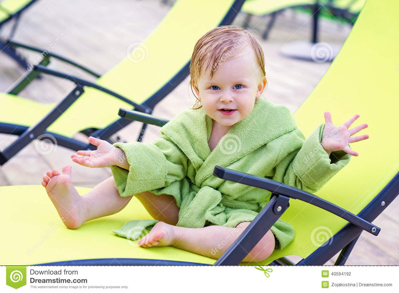 Portrait of a toddler in the lounge chair stock photo for Toddler sitting chair