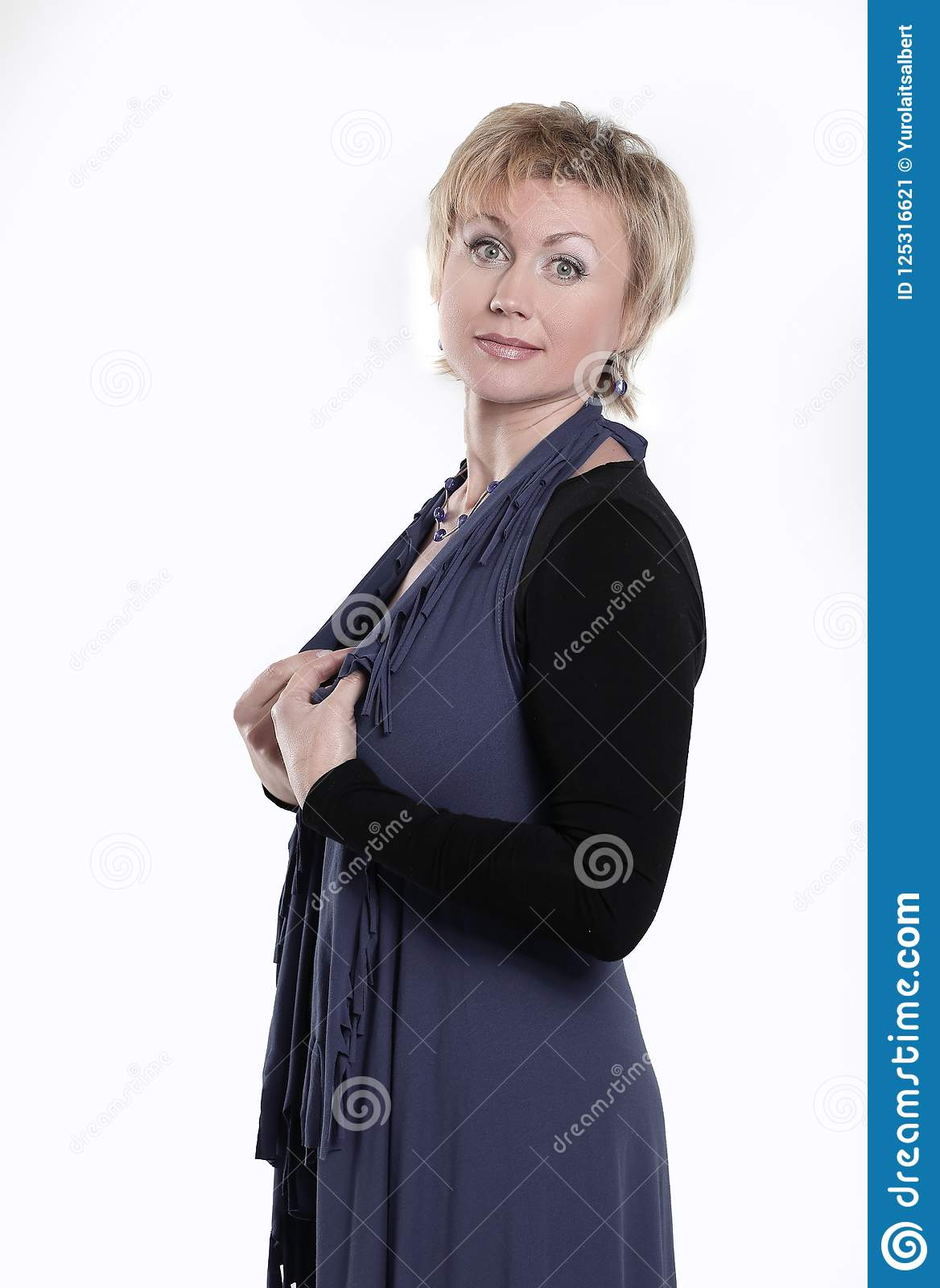 Portrait of trendy woman in grey dress with scarf