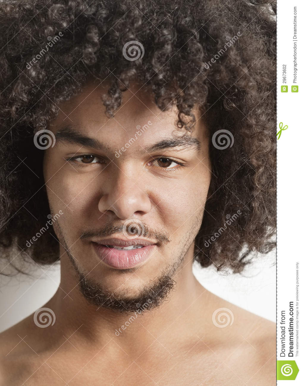 Portrait Of A Trendy Young Man With Curly Hair Over White